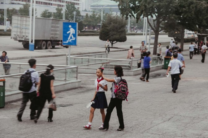 People outside the Kwangbok supermarket in Pyongyang North Korea